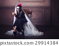 Beautiful woman painted as skeleton. Halloween  29914384