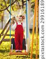 happy little girl on swings 29916189