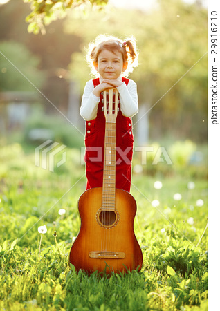 cute little girl with guitar 29916210