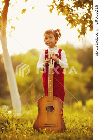 cute little girl with guitar 29916216