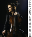 Beautiful cello player and her instrument 29928694