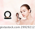 Beauty makeup model holding powder foundation 29929212