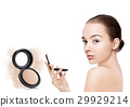 Beauty makeup model holding powder foundation 29929214