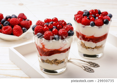 Healthy yogurt dessert with muesli and berries. 29930735