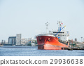 Logistic red ship waiting to dock and load goods 29936638