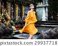 Beatiful girl is posing in a jungle temple 29937718