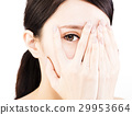 young woman covering her eyes by hands 29953664