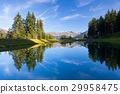 Lake on the top above alpine village of Alpbach  29958475