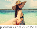 Woman wanting her man to follow her in vacation  29961519