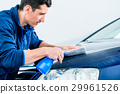 Proud car owner cleaning his vehicle 29961526