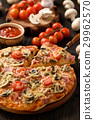 Homemade pizza with ham,mushrooms, tomatoes 29962570