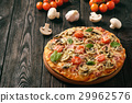 Homemade pizza with ham,mushrooms, tomatoes 29962576