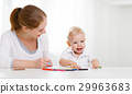 Mother with baby son with colored pencils 29963683