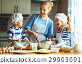 happy family in kitchen. mother and children preparing dough, ba 29963691