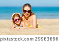 Happy family mother and child daughter  on beach in summer 29963696