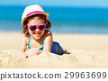 Happy child girl in bikini on beach in summer sea 29963699
