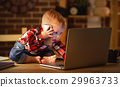 concept of baby boy working on computer and talking on phone 29963733