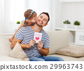 Father's day. Happy family daughter giving dad greeting card 29963743
