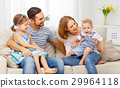 Happy family  laughing and hugging at home on sofa 29964118