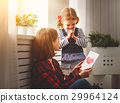 Happy mother's day! Daughter gives her mother an postcard 29964124
