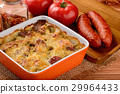 Casserole with potatoes, sausages, tomatoes,cheese 29964433