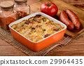 Casserole with potatoes, sausages, tomatoes,cheese 29964435