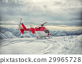 Helicopter mountain rescue service in the winter 29965728