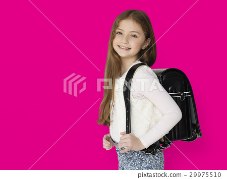 Young freckled girl carrying a backpack smiling portrait 29975510