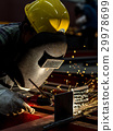 Worker with protective mask welding metal 29978699