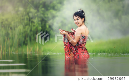 Thai Woman bathing in the river 29982065
