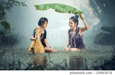 Asian sister in the rain 29983678