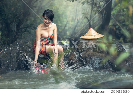 Asian sexy woman bathing in creek 29983680