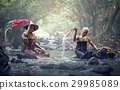 Asian old women washing clothes at the creek 29985089