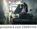 Asian model posing with old truck in an outdoor  29985445