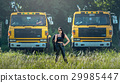 Asian model posing with truck in an outdoor  29985447