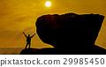 man celebrating his success top a mountain at suns 29985450