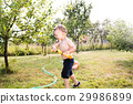 Little boy with water gun splashing somebody 29986899