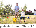 Little boy with father playing with water guns 29986973