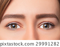 Closeup shot of woman eye with day makeup 29991282