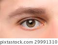 Beautiful brown man eye close up 29991310