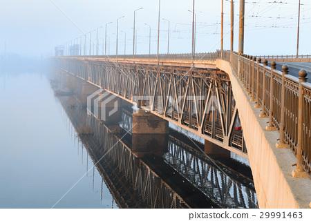 Railway bridge in the rays of the rising sun 29991463