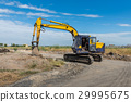 construction site with dirty yellow excavator  29995675