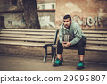 African-american streetball player resting. 29995807