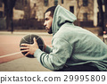 African-american streetball player resting. 29995809