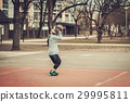 African-american streetball player practicing 29995811