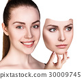 Woman hiding hapyiness under the serious mask 30009745