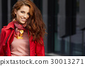 Spring woman in red coat 30013271