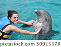 woman dancing with dolphin 30015378
