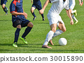 Soccer players in action 30015890