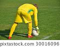 Soccer goalkeeper ready to kick the ball 30016096
